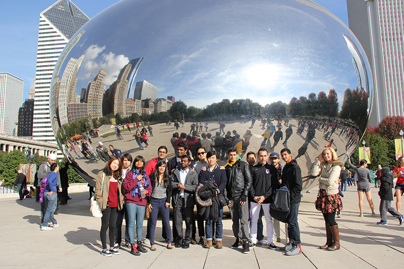 Members of International Student Club pose for a picture in front of the famous Chicago structure, Cloud Gate