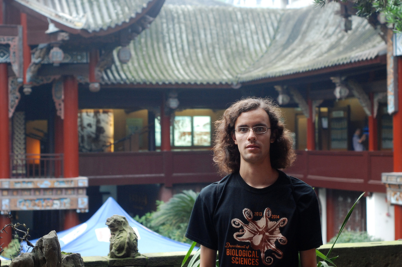 Photo of Reuben Ng standing in front of a pagoda in China