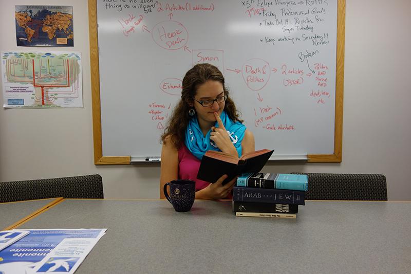 Eva Lapp reads a book in a classroom