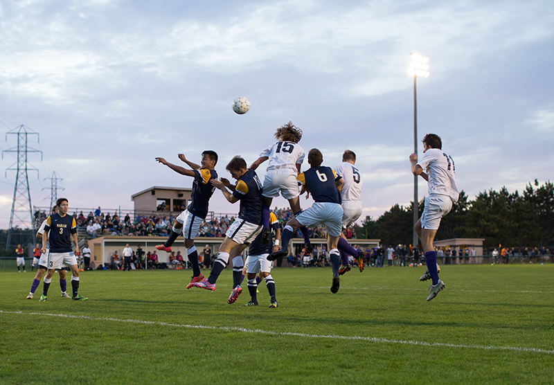 players jump up for a header