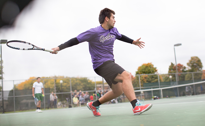 tennis player swings racket