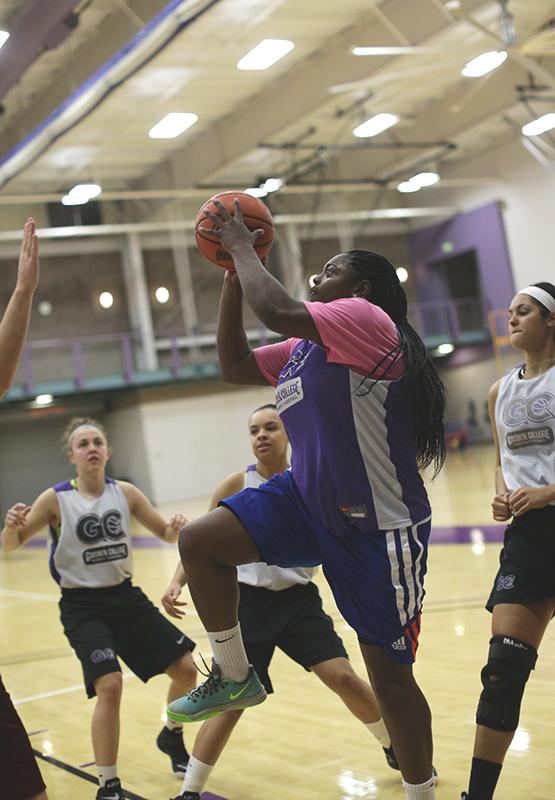Tyra Carter shoots ball during practice