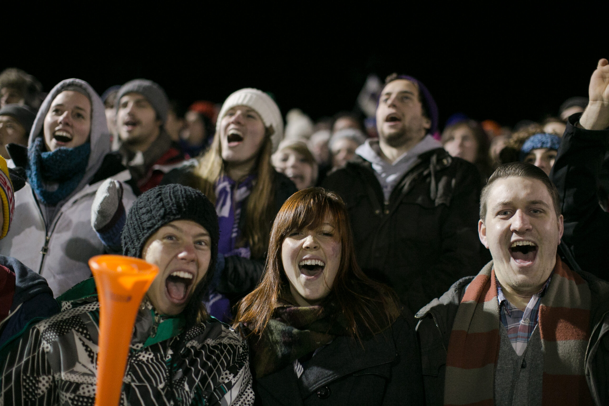 Goshen College students cheer for the men's soccer team at a packed game