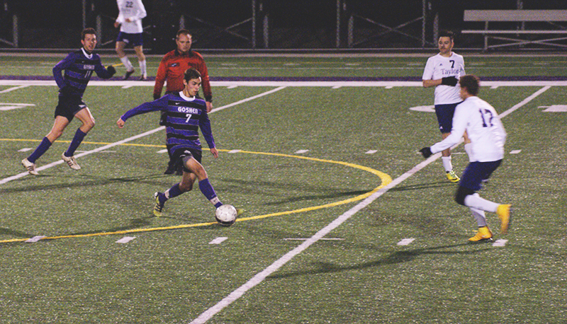 Soccer player dribbles down field