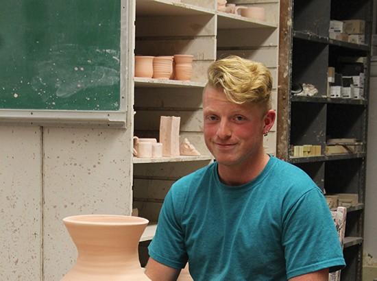 Portrait of Seth Krabill in ceramic studio