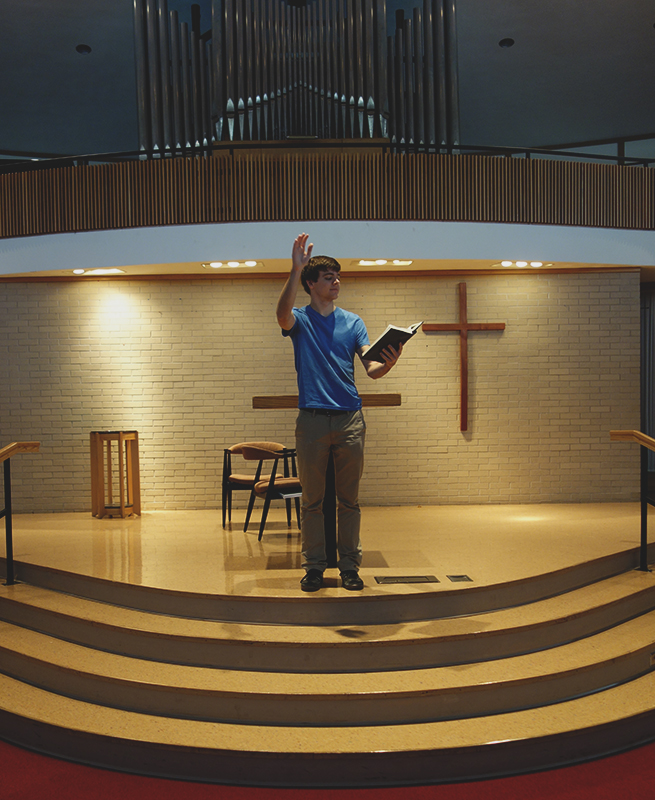 Stephen Graber conducts a hymn in the Church-Chapel