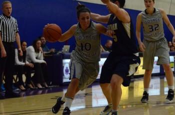 Avery Bishoff, senior, dribbles around opponent