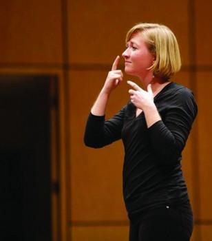 Brianna Brubaker, senior, interprets a song during the fall 2014 Kick Off.