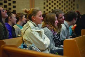 A group of student athletes sit in the Chapel during the China SST convocation