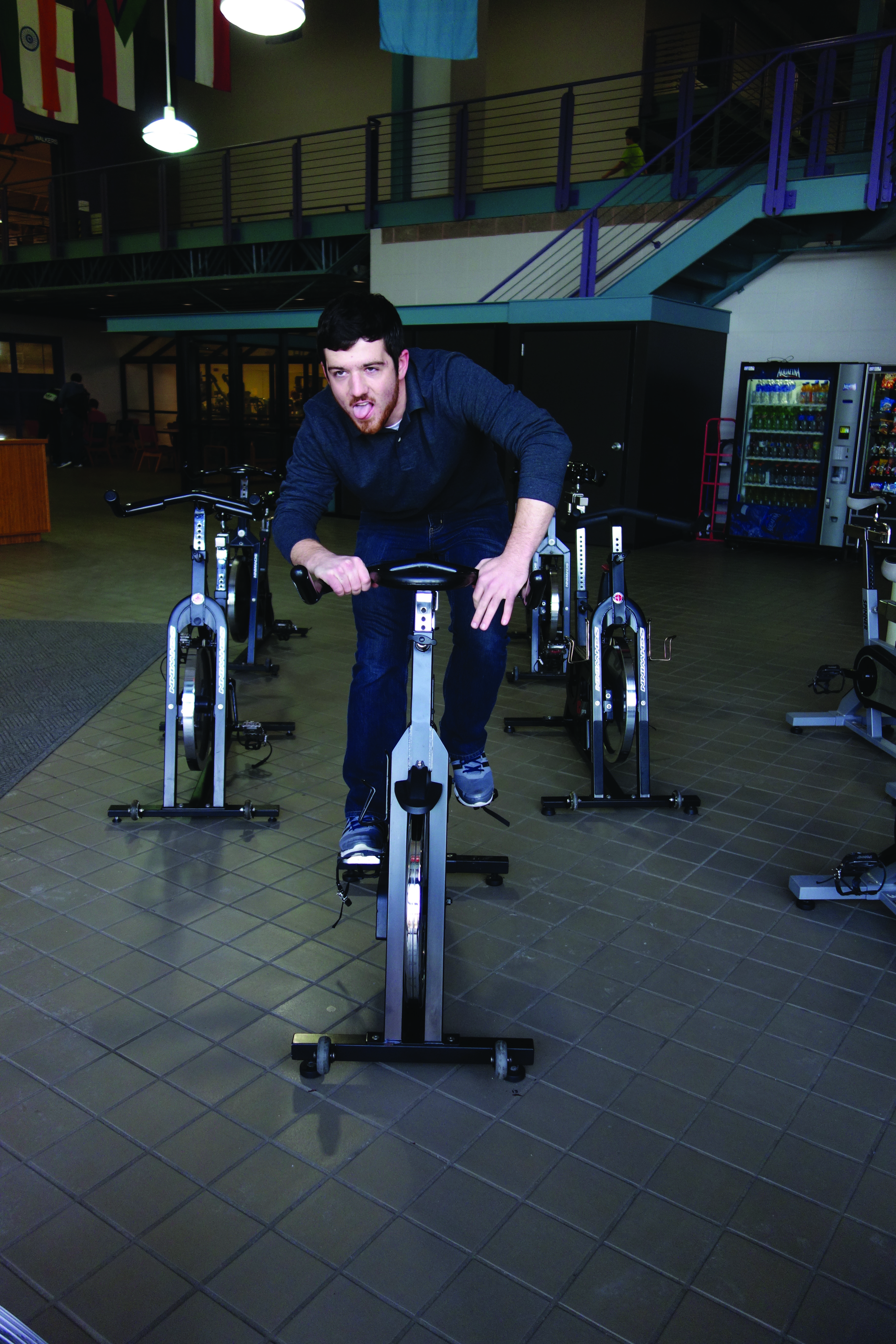 Brian Sutter works out on a stationary bike