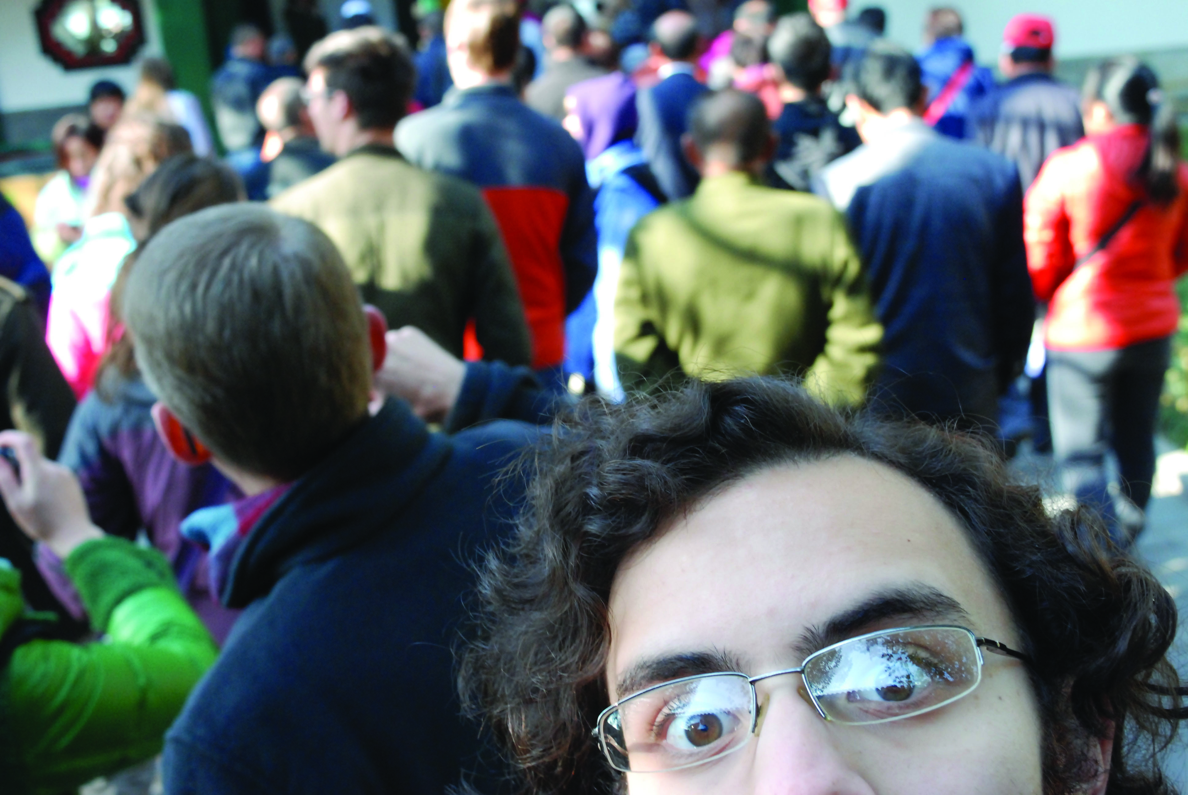 Reuben takes a selfie featuring only his eyes, forehead, and the crowd behind him