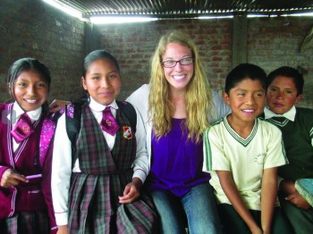 Goshen graduate Kate Stoltzfus stands with some of her students from her SST semester in Peru