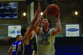 Trevor Commissaris, a junior, goes up for a lay up against a Spring Arbor defender