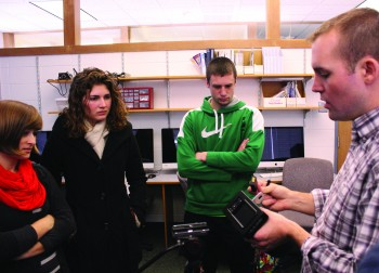 Students Hannah Sauder, junior, Elizabeth Derstine, junior and Dalton Shetler obvserve professor Seth Conley in class.