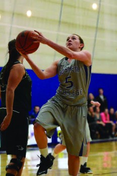 Liz Tecca, junior, goes for a lay up during the game