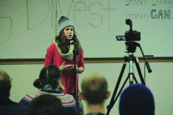Hannah Barg, a junior, speaks at the student-organized Divestment Day Potluck this past Saturday