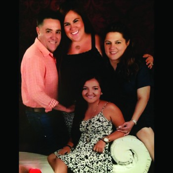 Enrique Fonseca, stands with his wife, Elizabeth and his two daughters: Frances, a sophomore at Goshen College, and Ashley.