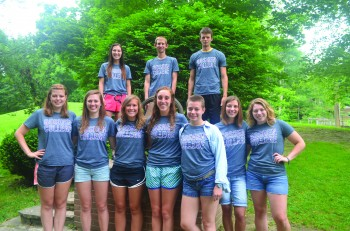 Maddie Birky, a sophomore, stands with fellow  camp counselors from Camp Friedenswald over the summer