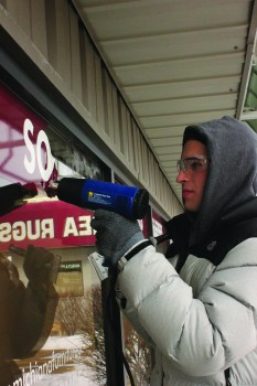 Caleb Liechty, a first-year, works at Habitat during the habitat service days in January.
