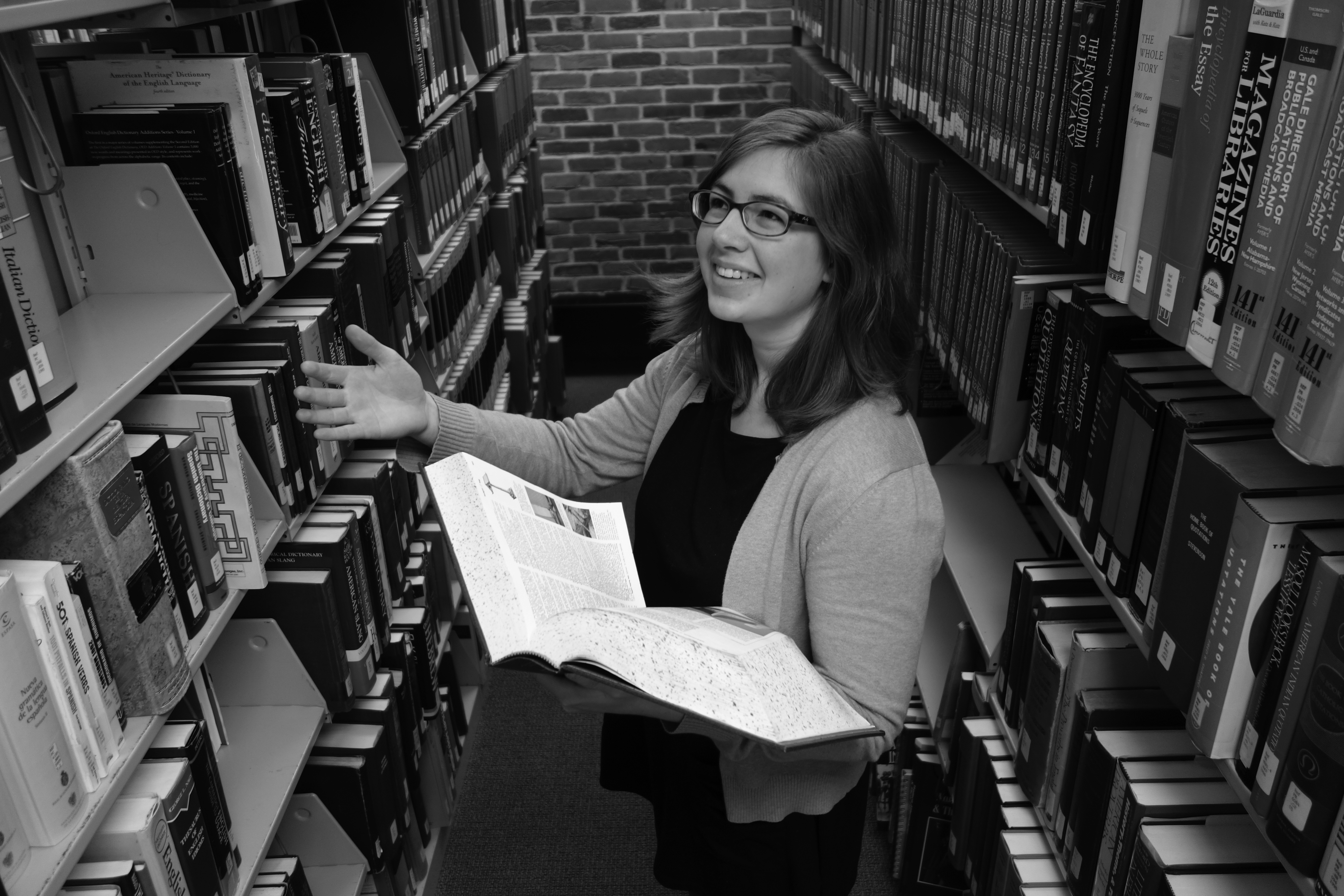 Kate Yoder holds a book and laughs in the Good Library