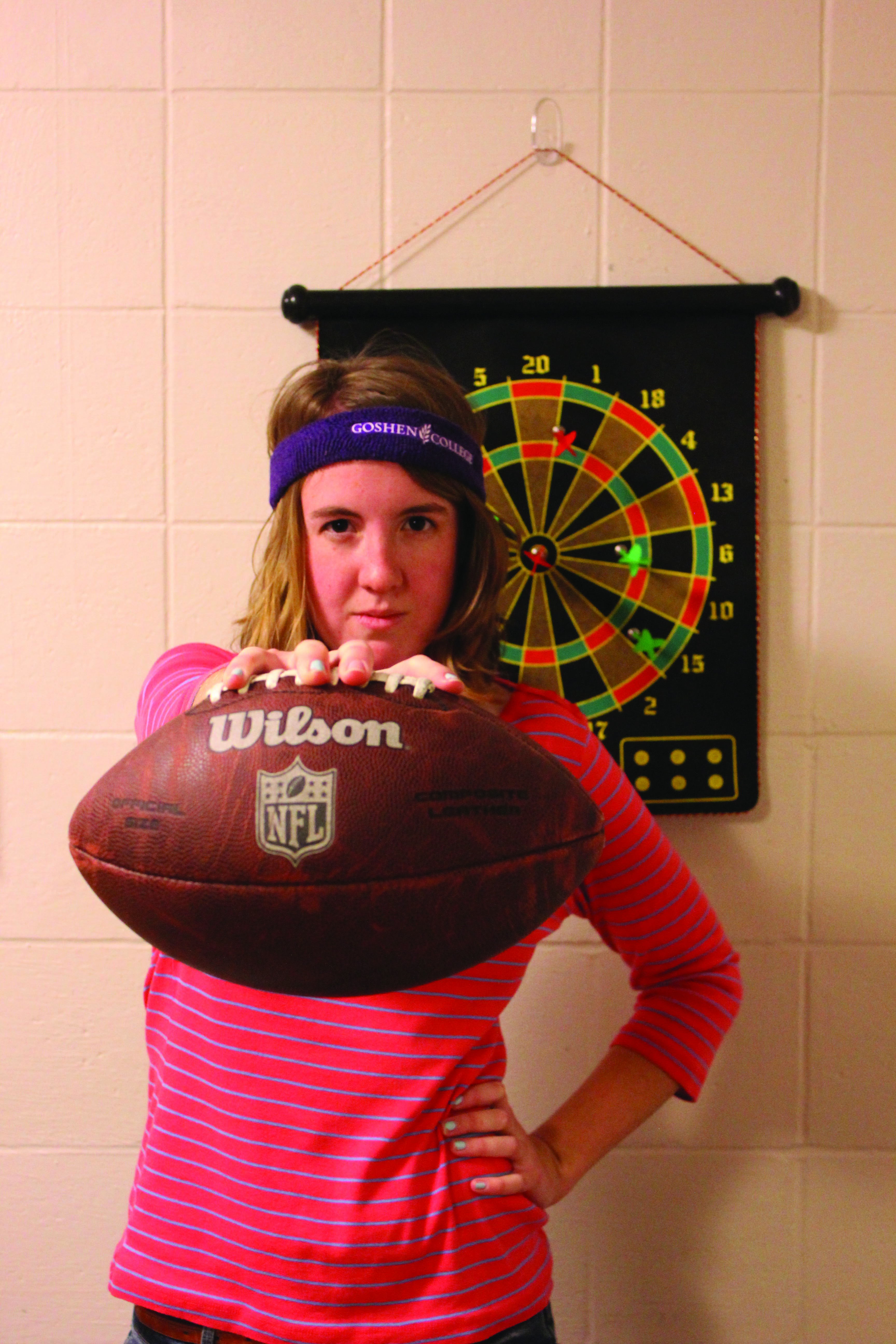 Leah Landes holds a football