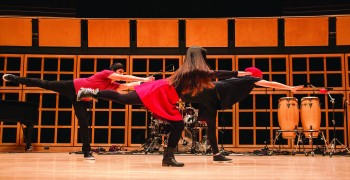 Lyrical Hip-Hop club members Stefan Baumgartner, senior, and  juniors Olivia Ginn and Jose Mendoza perform a routine during Kick Off.