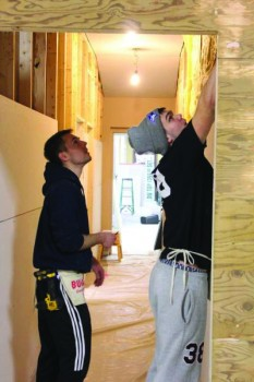 Ryan Hartig, first-year, and Jacob Roth, sophomore  help out at Habitat for Humanity in January.