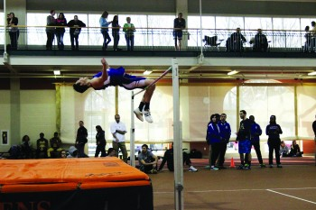 Derek Swartzendruber, senior clears his height in the high jump at Anderson University on Saturday