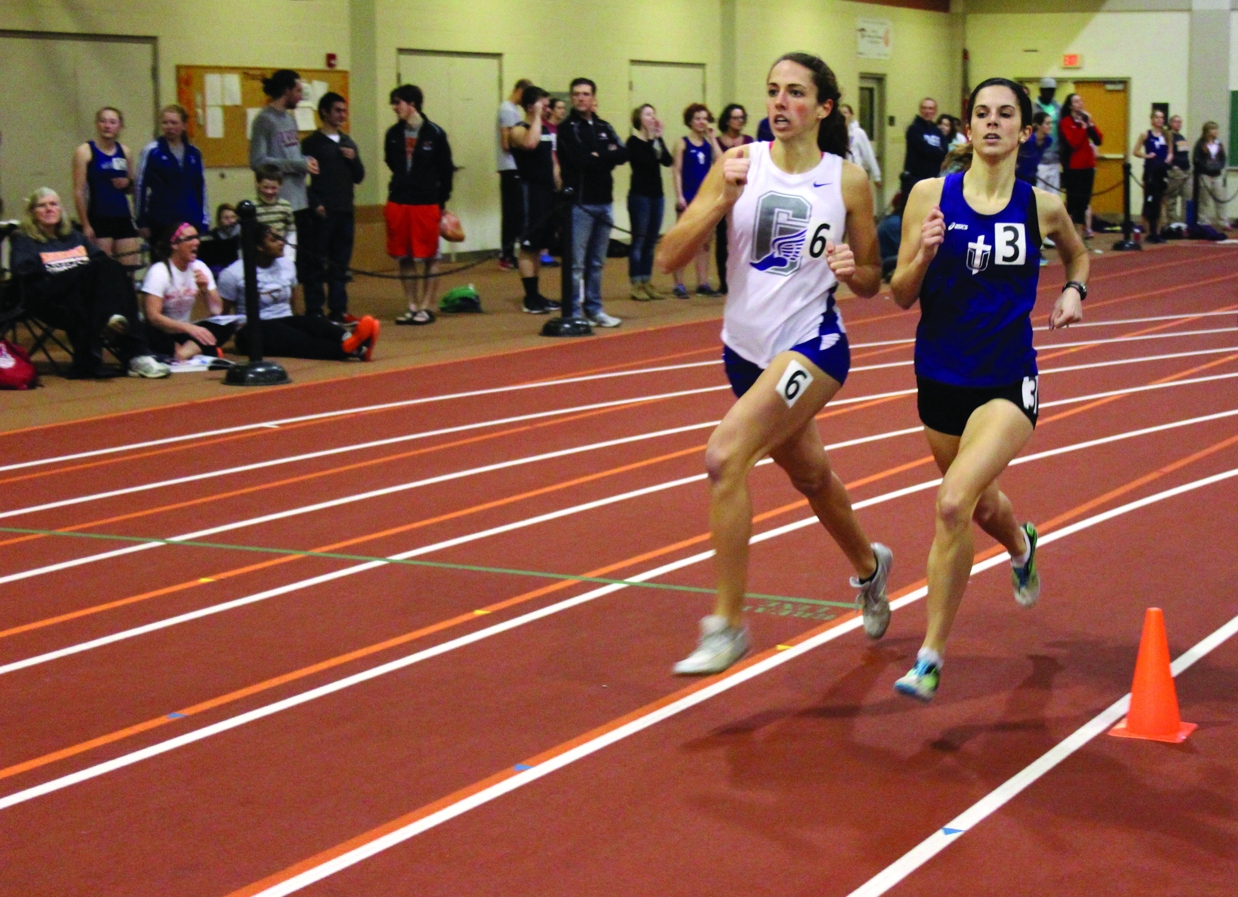 Mollie Nebel passes an opposing runner during a race at an indoor track meet