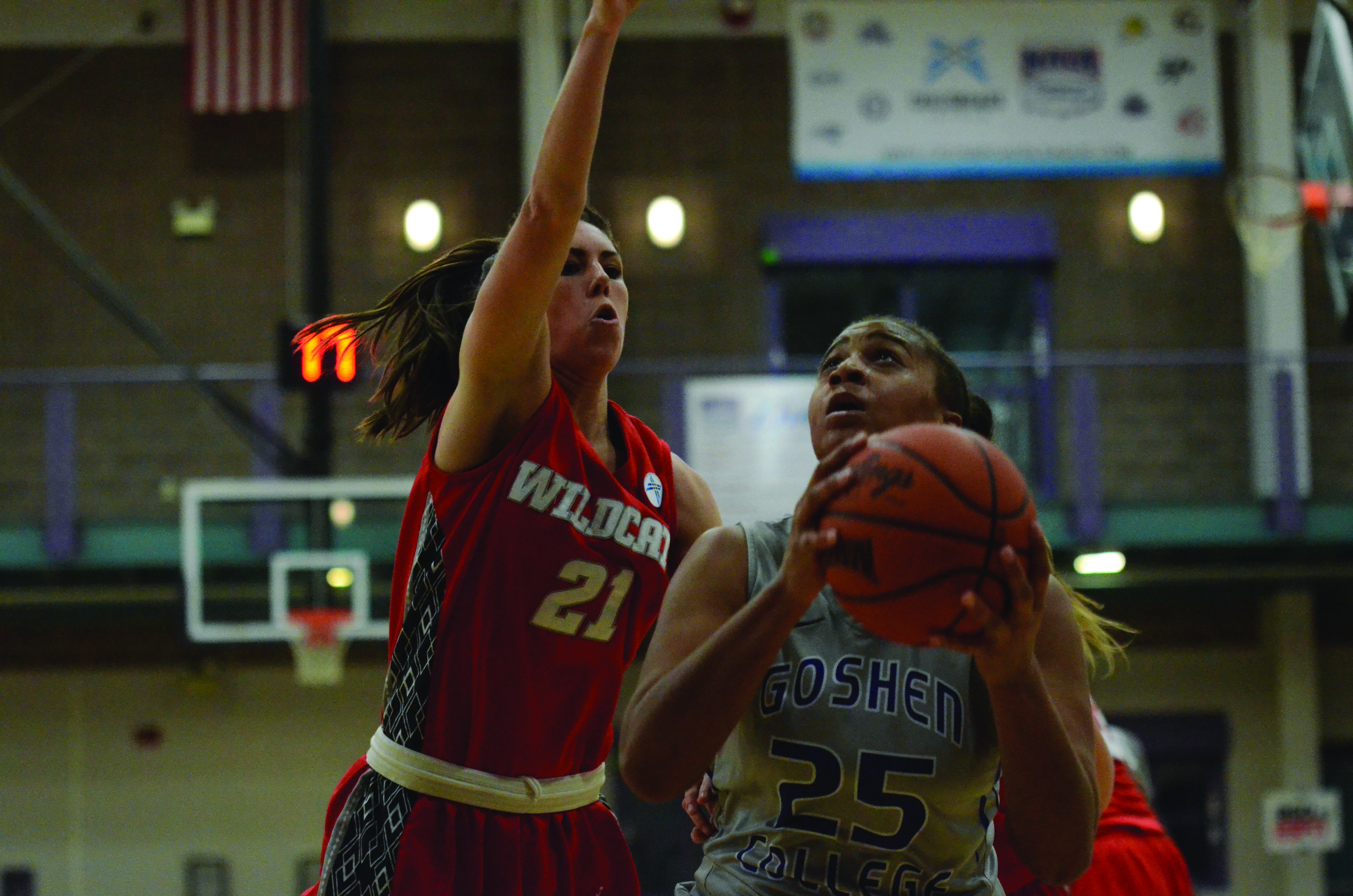 Keshia Ward fends off a defender while preparing for a shot