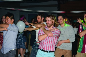 Minah Kim, Andre Eisenbeis, Isaiah Freisen and Timothy Bixler participate in in the Macarena during the 90's prom event from this weekend.