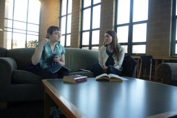 Eliana Neufeld Basinger, a first-year, sits with Hannah Quast, the campus minister for the Catholic Diocese of Ft. Wayne-South Bend before a Catholic Communities meeting.
