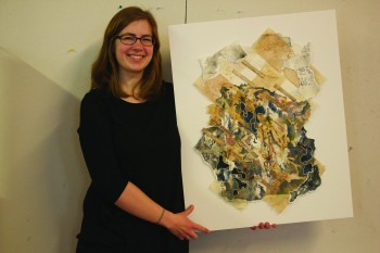 Kate Yoder, a senior art and English writing double major from Elkhart, models one of her pieces of artwork