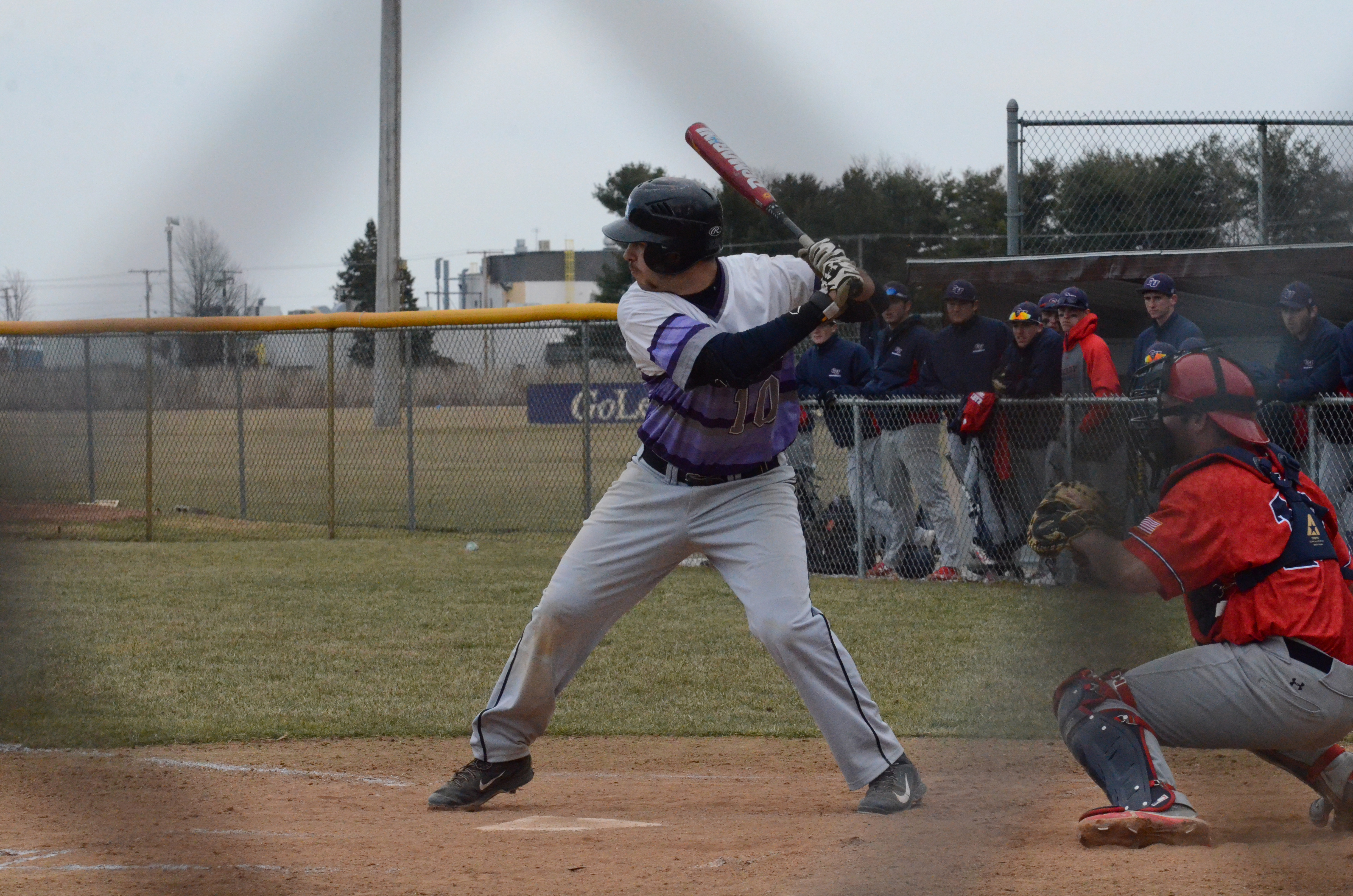 A Goshen player prepares to swing at an oncoming pitch during a game