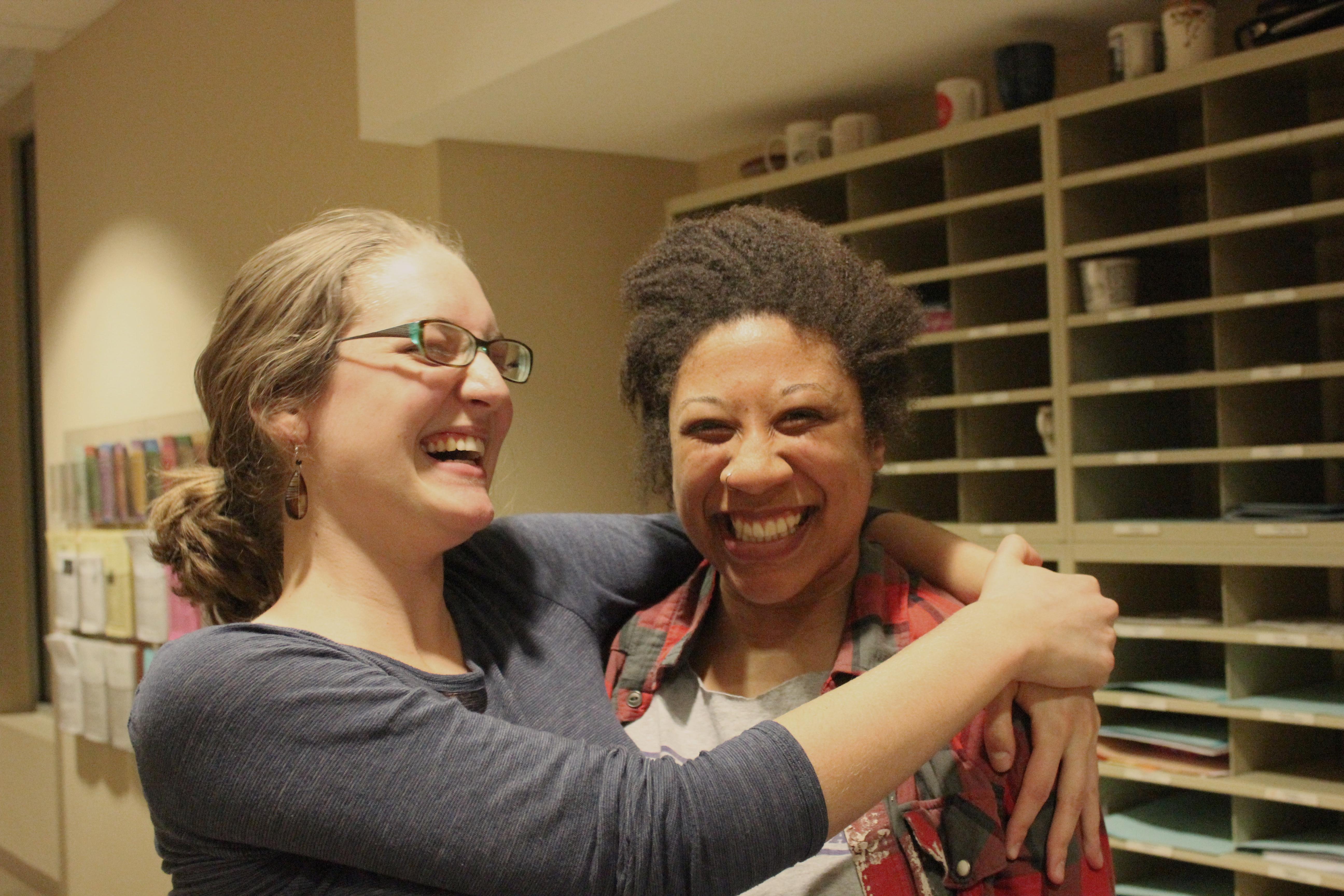 Eva Lapp and Dominique Chew laugh and embrace