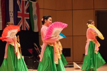 Chau Bui and Sam Weaver, seniors, performed a traditional Vietnamese dance at the International Student Coffeehouse.