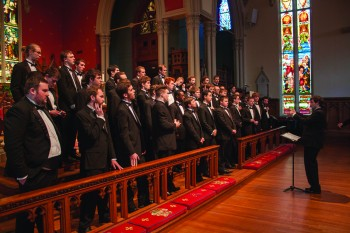 Senior Brody Thomas conducts the men in song on the Men's Chorus spring break tour to New Orleans last week.