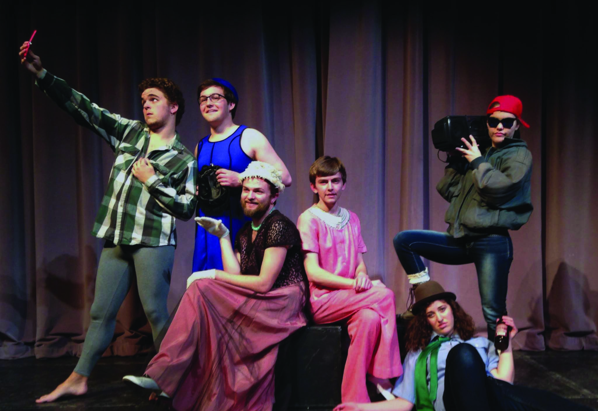 Student actors pose for a picture in cross-dressed costumes