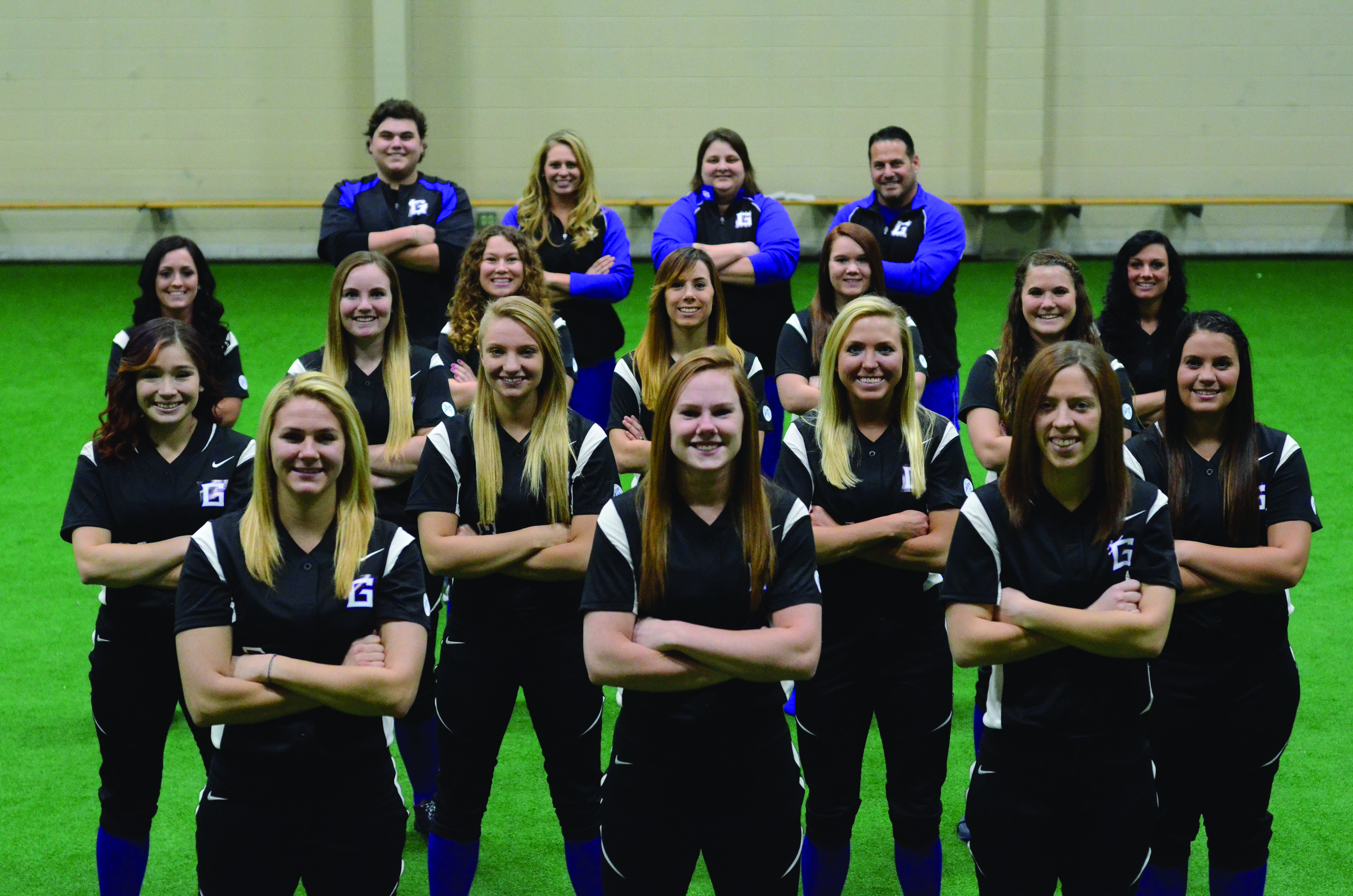 The 2014-2015 women's softball team poses for a picture