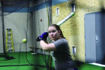 Mackenzie Davenport, a first-year, concentrates on a hitting exercise during practice.