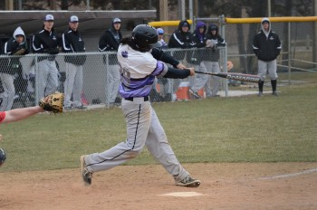 Cody McCoy, a first-year takes a swing at bat.