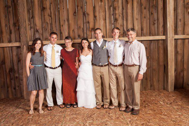 Karsten Hess poses with his family for a picture at his brother's wedding