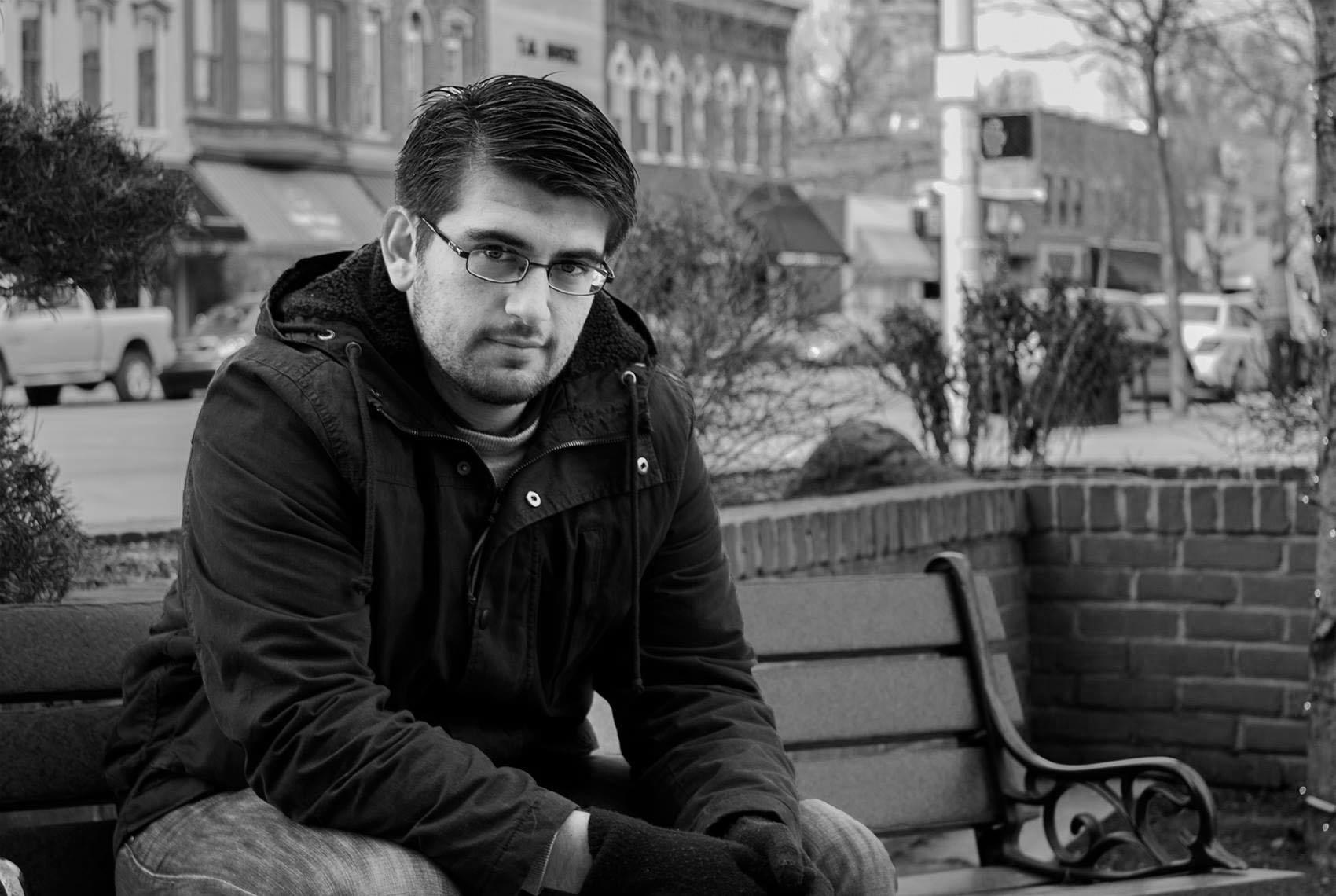 Luis Perez Lerchundi sits on a park bench