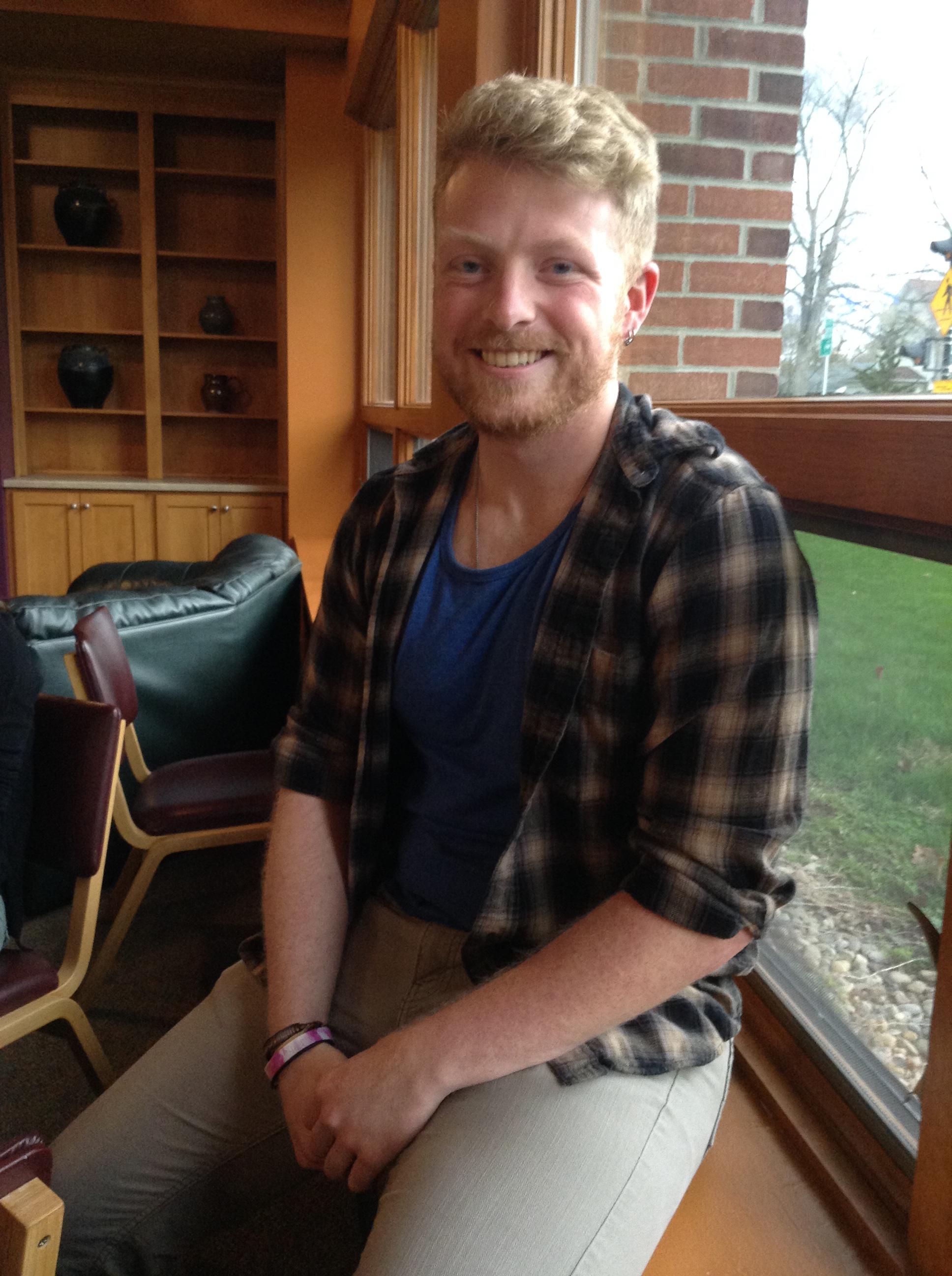 Seth Kraybill sits in a windowsill