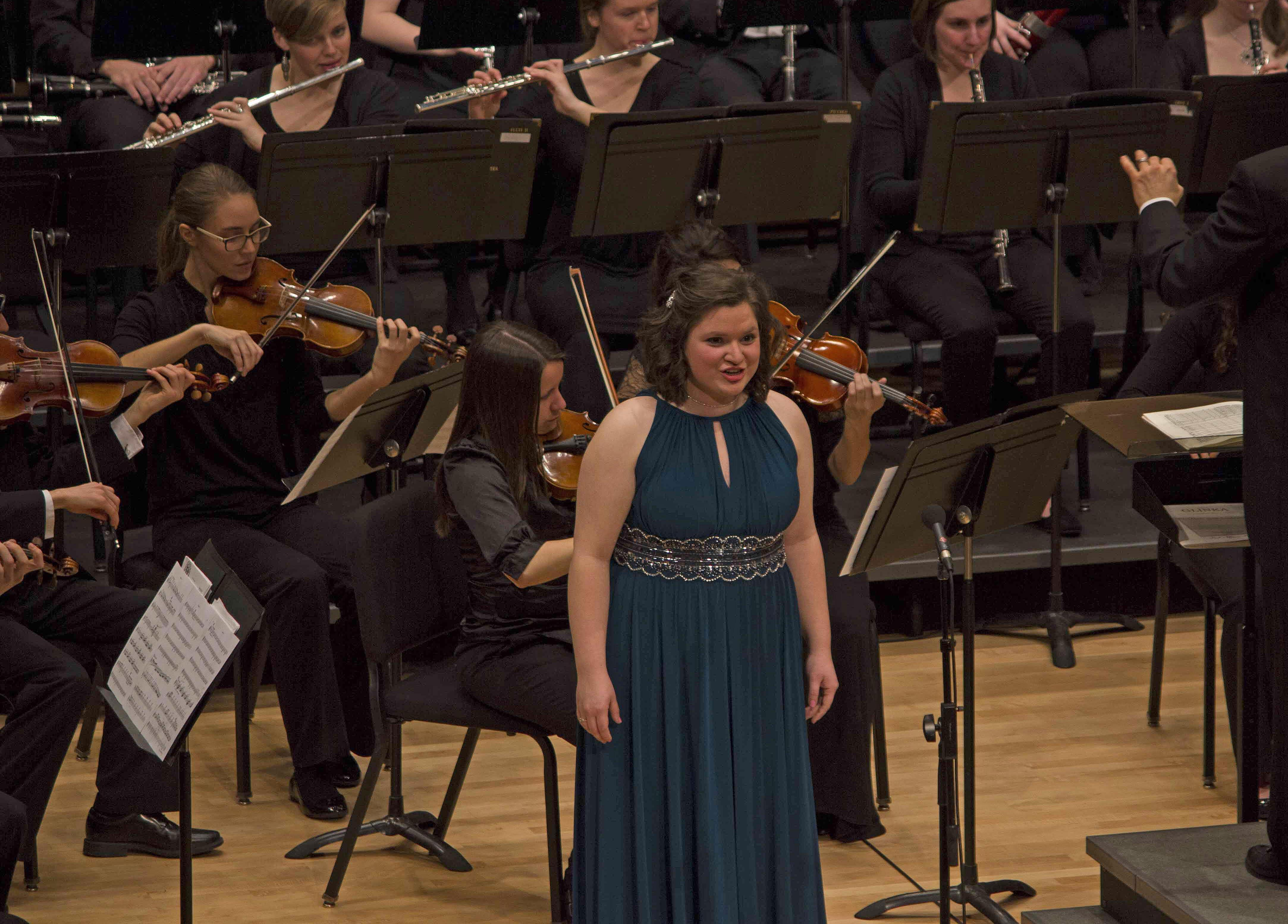 Miranda Earnhart sings an aria with the Goshen orchestra during the Concerto-Aria concert in Sauder Hall