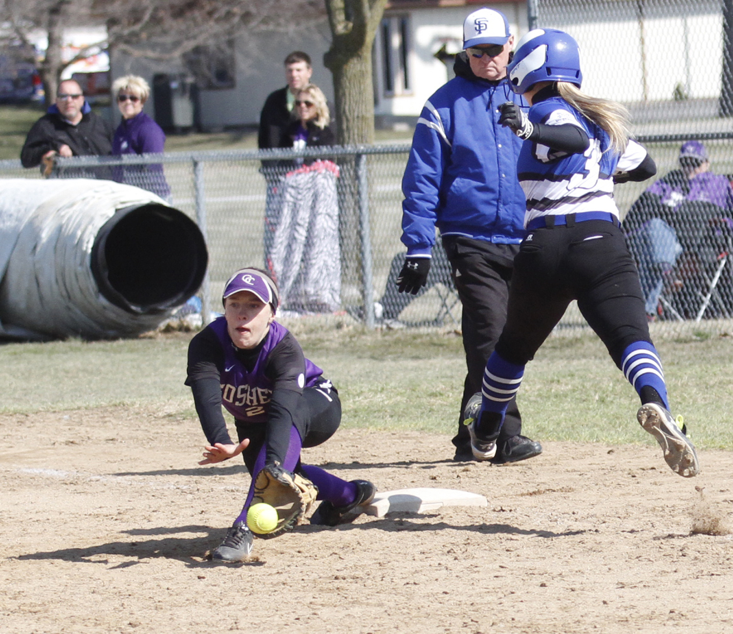 Abby Flickner reaches for an incoming throw during a softball game