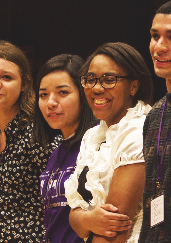 Armarlie Grier laughs while standing with other students