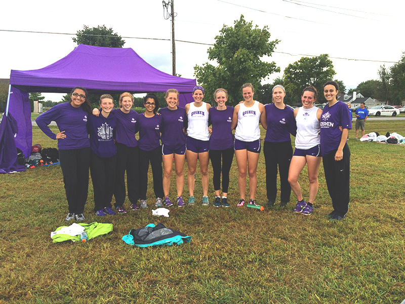 Women's cross country team poses after a race, under the new direction of Coach Nyce. Photo contributed by Hannah Barg.