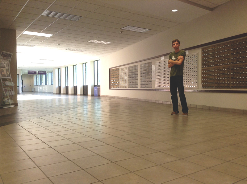 Jacob Penner stands in hallway of the Union Building