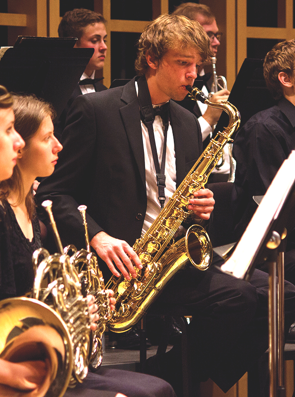 Jacob Penner plays tenor saxophone with the Goshen College orchestra